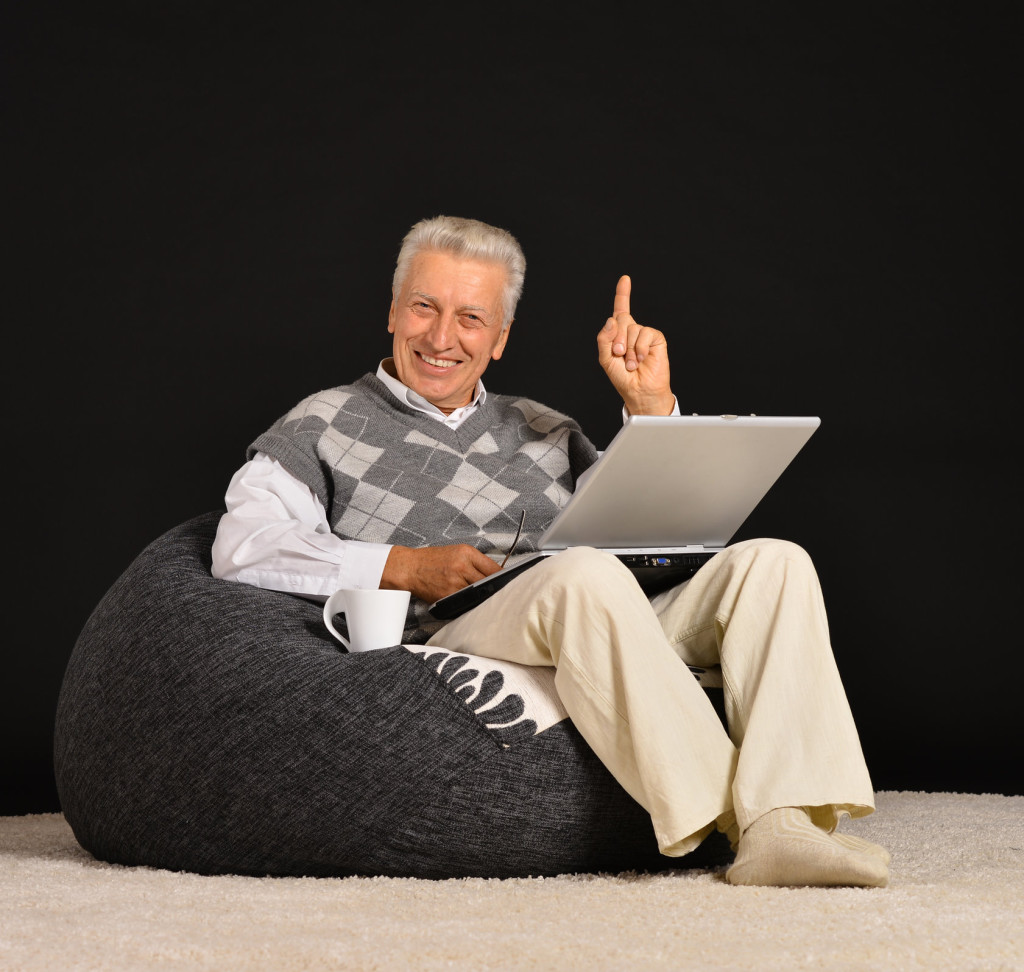 Elderly man with laptop
